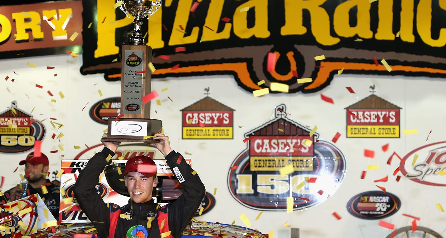 NEWTON, IA – MAY 17: Ben Rhodes, driver of the #41 Alpha Energy Solutions Chevrolet celebrates in victory lane after winning the NASCAR K&N Pro Series Casey's General Stores 150 at Iowa Speedway on May 17, 2014 in Newton, Iowa. (Photo by Todd Warshaw/NASCAR via Getty Images)