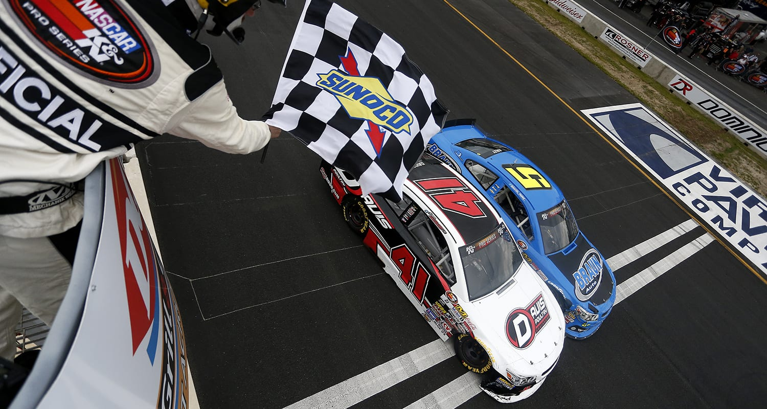 WOODFORD, VA – MAY 30: Spencer Davis, driver of the #41 Davis Poultry/Ruud.com Chevrolet, takes the checkered flag in front of Justin Haley, driver of the #5 Braun Auto Chevrolet, to win the NASCAR K&N Pro Series East ComServe 150 on May 30, 2016 in Woodford, Virginia. (Photo by Matt Hazlett/NASCAR via Getty Images)