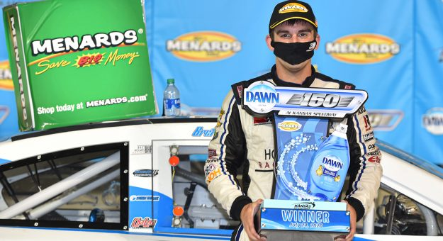 Bret Holmes, driver of the #23 Holmes II Excavation Chevrolet, holds the trophy after winning the ARCA Menards Dawn 150 on July 24, 2020 at Kansas Speedway in Kansas City, Kansas. (Ed Zurga/ARCA Racing)