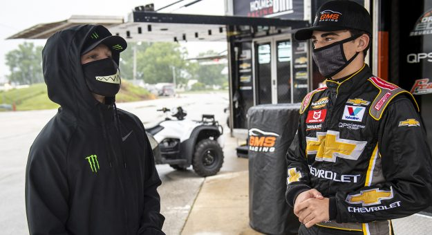 Ty Gibbs, driver of the #18 Monster / Terrible Herbst / ORCA Toyota, and Sam Mayer, driver of the #21 Chevy Accessories Chevrolet, talk during a weather delay in the Menards 200 presented by Crosley Brands for the ARCA Menards Series on August 1, 2020 at at Toledo Speedway in Toledo, Ohio. (Nic Antaya/ARCA Racing)