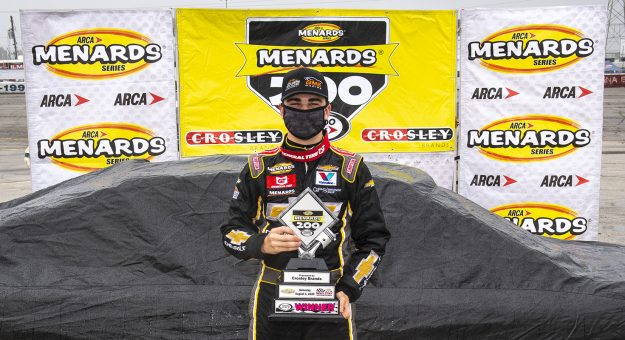 Sam Mayer, driver of the #21 Chevy Accessories Chevrolet, poses in Victory Lane after the Menards 200 presented by Crosley Brands for the ARCA Menards Series on August 2, 2020 at at Toledo Speedway in Toledo, Ohio. (Nic Antaya/ARCA Racing)
