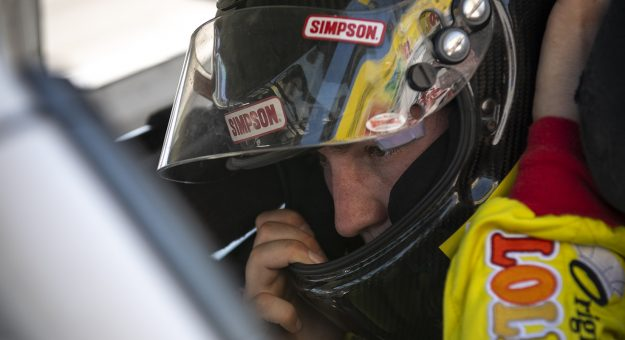 Derek Griffith, driver of the #22 Original Gourmet Lollipops Ford, adjusts his helmet during the practice of the Menards.com 200 presented by SPxE for the ARCA Menards series on July 31, 2020 at at Toledo Speedway in Toledo, Ohio. (Nic Antaya/ARCA Racing)