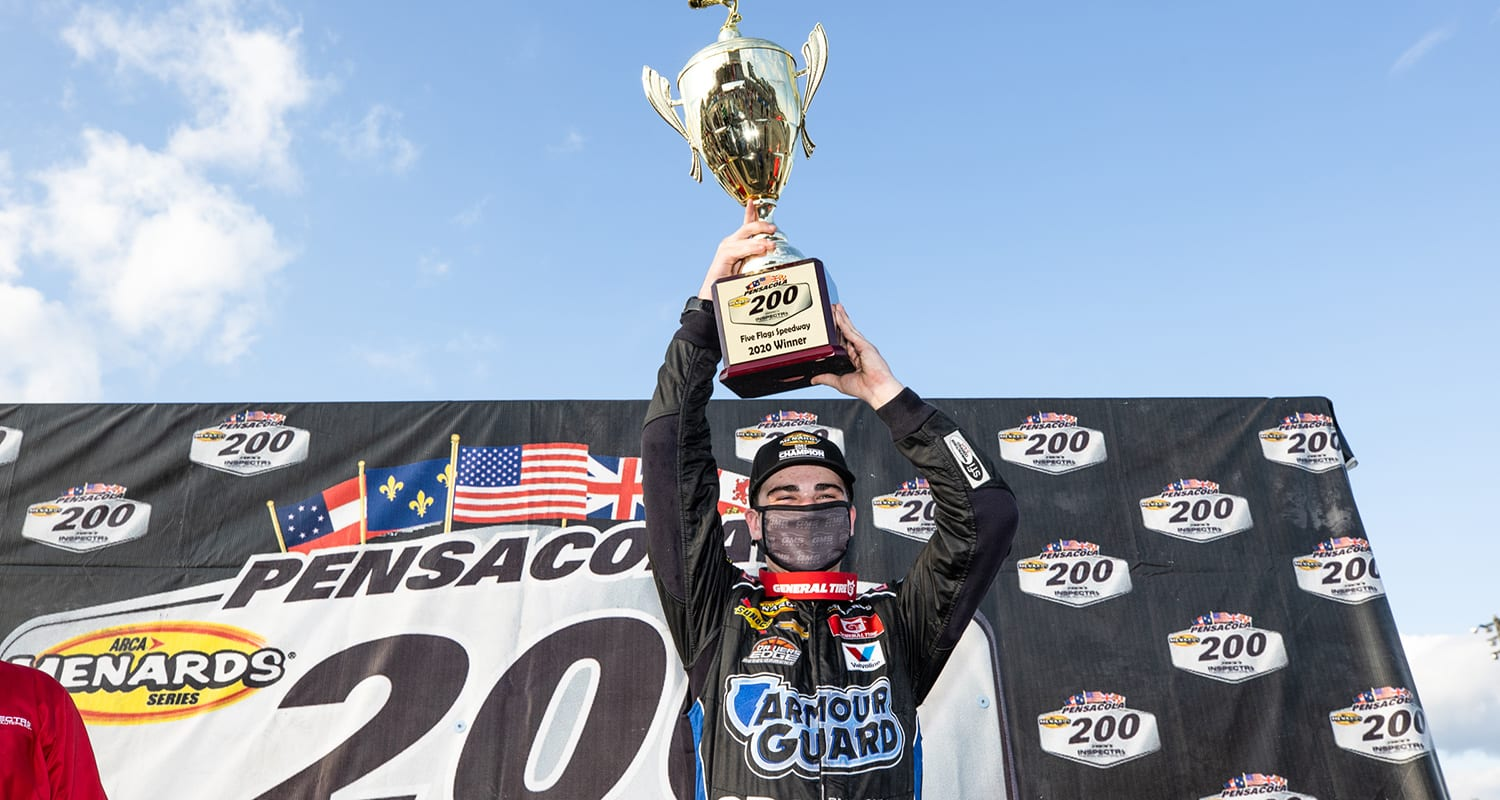 Sam Mayer, driver of the No. 21 End Stigma, Change Lives Chevrolet, celebrates winning the Pensacola 200 Presented by Inspectra Thermal Solutions and the ARCA Menards Series East Championship in Pensacola, Florida on Oct. 11, 2020. (Morgan Givens/ARCA Racing)