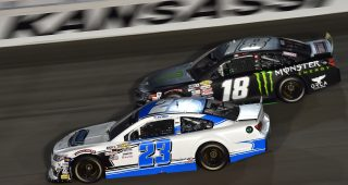 Bret Holmes, driver of the #23 Holmes II Excavation Chevrolet, and Riley Herbst, driver of the #18 Monster Energy/Terrible Herbst/ORCA Toyota, race during the ARCA Menards Dawn 150 on July 24, 2020 at Kansas Speedway in Kansas City, Kansas. (Ed Zurga/ARCA Racing)