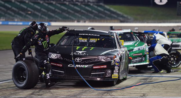 Crew members for Riley Herbst, driver of the #18 Monster Energy/Terrible Herbst/ORCA Toyota, change tires during the ARCA Menards Dawn 150 on July 24, 2020 at Kansas Speedway in Kansas City, Kansas. (Ed Zurga/ARCA Racing)