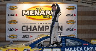 Bret Holmes, driver of the #23 Golden Eagle Syrup Chevrolet celebrates winning the 2020 series championship during the Speediatrics 150 for the ARCA Menards Series at Kansas Speedway on Friday, October 16, 2020. (Barry Cantrell/ARCA Racing)