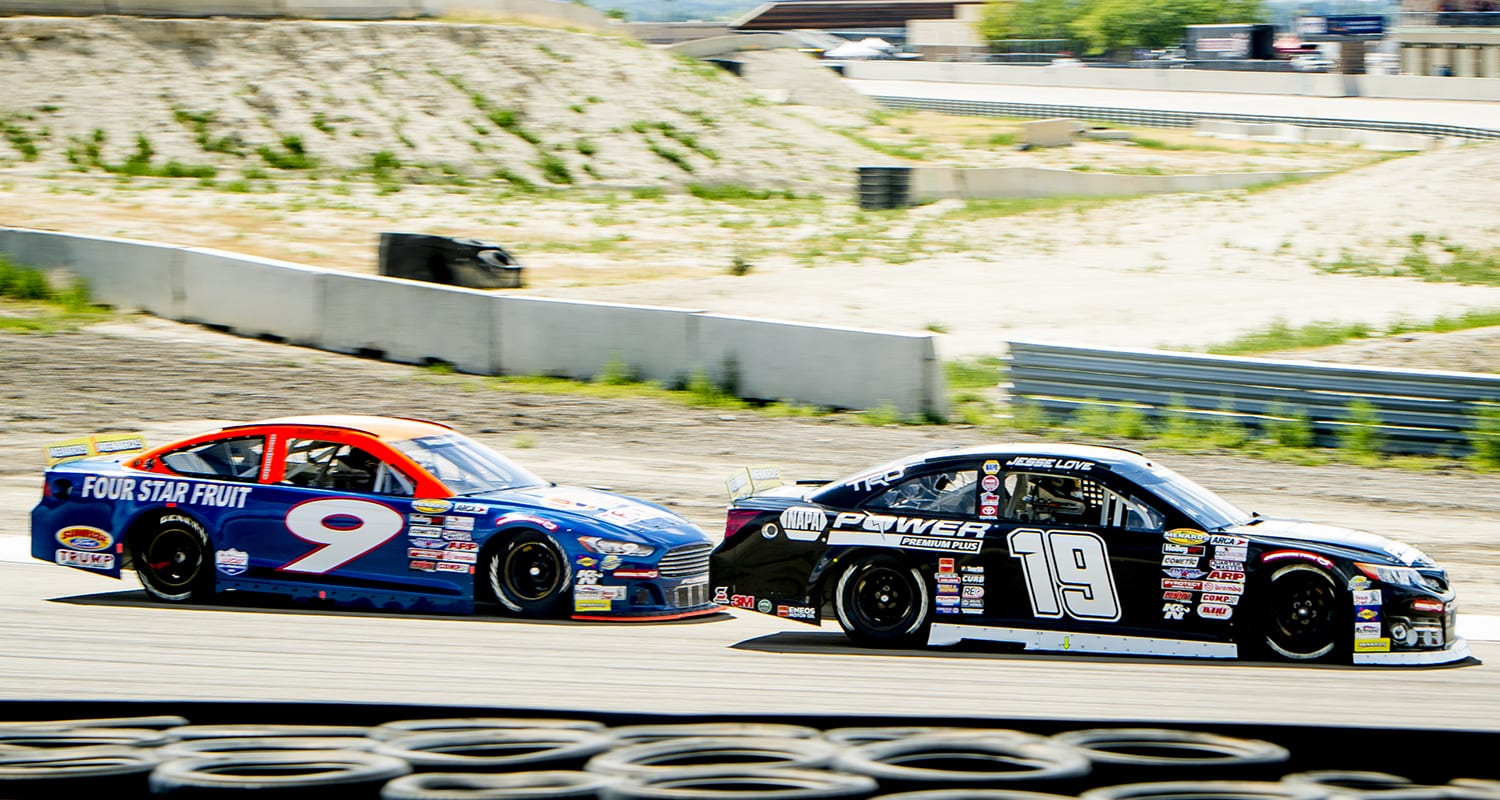 Jesse Love, driver of the #19 NAPA Power Premium Plus Toyota, passes Blaine Perkins, driver of the #9 Sunrise Ford/Four Star Fruit-Lucas Oil Ford, during the first ENEOS/Sunrise Ford Twins presented by West Coast Stock Car Hall of Fame race for the ARCA Menards Series West at the Utah Motorsports Campus in Tooele, Utah, on Saturday, June 27, 2020. (Isaac Hale/ARCA Racing)