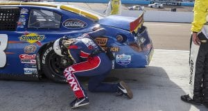 Sarah Burgess tries to repair her daughter Bridget's damaged No. 88 HMH Construction Toyota during the Arizona Lottery 100 for the ARCA Menards Series West at Phoenix Raceway in Avondale, Arizona, on Nov. 7, 2020. (Dominic Valente/ARCA Racing)