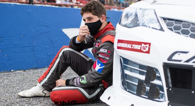 Nick Sanchez, driver of the No. 6 NASCAR Technical Institute Toyota, rests on his car before the Pensacola 200 Presented by Inspectra Thermal Solutions for the ARCA Menards Series East at 5 Flags Speedway in Pensacola, Florida on Oct. 11, 2020. (Morgan Givens/ARCA Racing)