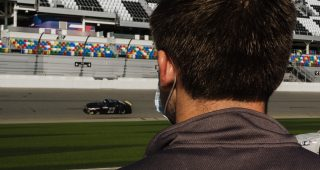 Bret Holmes watches teammate Sam Mayer drive the No. 23 Bret Holmes Racing Chevrolet during the ARCA Menards Series test at Daytona International Speedway in Daytona Beach, Florida, on Jan. 16, 2021. (Kate Gardiner/ARCA Racing)
