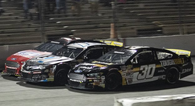Max Gutierrez, driver of the No. 30 Tough Built Ford, passes Sammy Smith (No. 18) and Taylor Gray (No. 17) in the final stretch to win the Jeep Beach 175 for the ARCA Menards Series East at New Smyrna Speedway in New Smyrna Beach, Florida, on Feb. 8, 2021. (Adam Glanzman/NASCAR)
