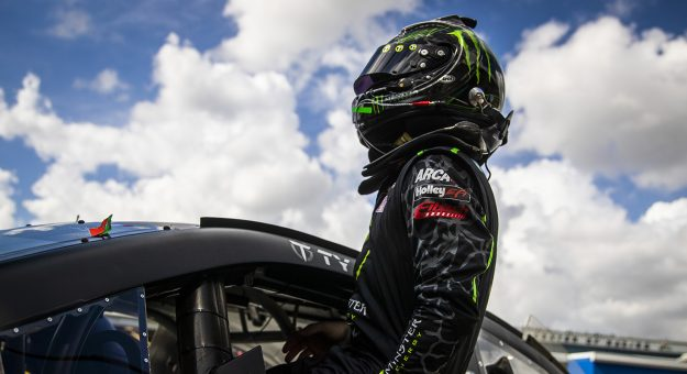 Ty Gibbs, driver of the No. 18 Monster Energy Toyota, exits his car after practice for the Lucas Oil 200 Driven by General Tire for the ARCA Menards Series at Daytona International Speedway in Daytona Beach, Florida, on Feb. 12, 2021. (Adam Glanzman/NASCAR)