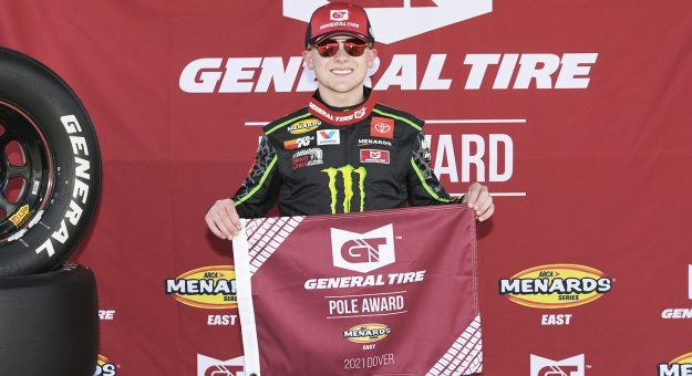 Ty Gibbs, driver of the #18 Joe Gibbs Racing Toyota, poses for a photo after winning the pole award of the last practice/qualifying of the General Tire 125 for the ARCA Menards Series East at Dover International Speedway in Dover, Delaware, on May 14, 2021. (Craig Hudson/ARCA Racing)