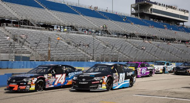 Race cars wait on pit lane for the start of practice before the Sprecher 150 for the ARCA Menards Series at the Milwaukee Mile in West Allis, Wisconsin, on Aug. 29, 2021. (Patrick McDermott/ARCA Racing)