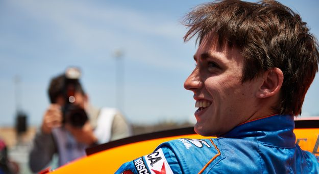 Jake Drew, driver of the #9 Sunrise Ford-Lucas Oil Ford, gets out of his car after qualifying on the pole at the General Tire 200 for the ARCA Menards Series at at Sonoma Raceway in Sonoma, California on June 5, 2021. (Matt Cohen/ARCA Racing)